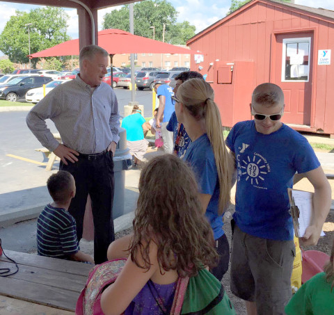 State Senator Tom McGarrigle visits with summer campers and staff.