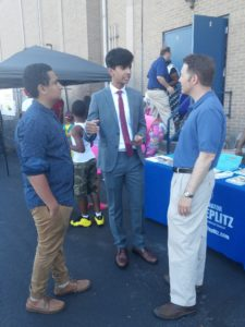 State Senator Rob Teplitz speaks with East Shore YMCA Youth and Government members Shawky Darwish and Sameer Khan