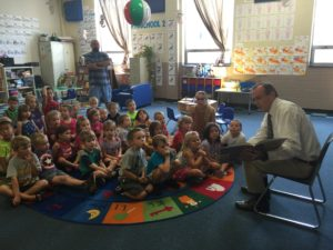 House Democratic Whip Rep. Mike Hanna reads to children at Lock Haven Area YMCA