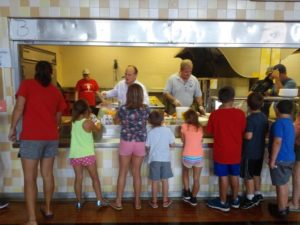 PA State Rep. Kerry Benninghoff and Centre Commissioner Steve Dersham exhibited servant leadership by helping to serve summer food at the YMCA of Centre County!
